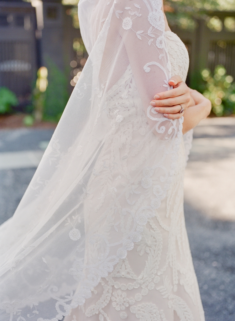 "Casablanca Bridal's ""Zinnia"" ivory cotton lace and champagne-colored satin fit-to-flare gown from Palmetto Bridal Boutique. Mariée Lace Veils' ""121"" princess lace veil. Kwiat diamond and ruby ring from Paulo Geiss Jewelers. (Photo by Corbin Gurkin)"