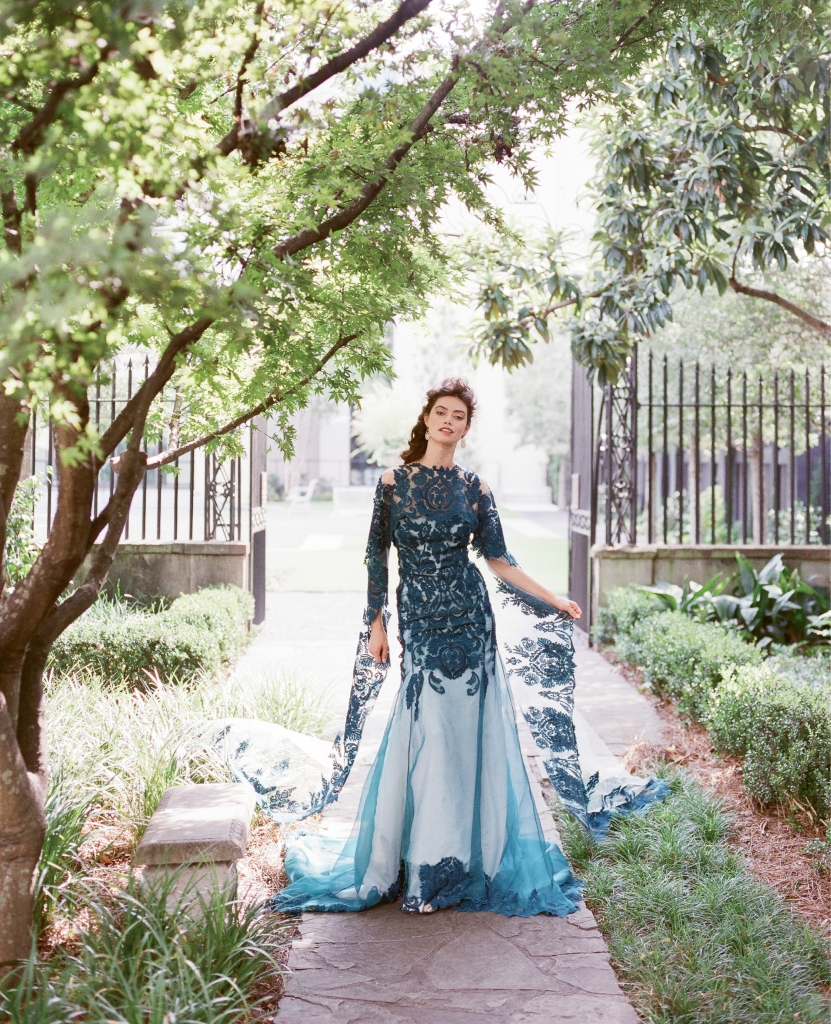 "Emily Kotarski's ""Queen Charlotte"" silk embroidered cape and gown from Emily Kotarski Bridal Studio. ""Grace"" topaz and iolite earrings from Peyton William Jewelry. Single Stone's diamond and gold ring from Croghan's Jewel Box. (Photo by Corbin Gurkin)"