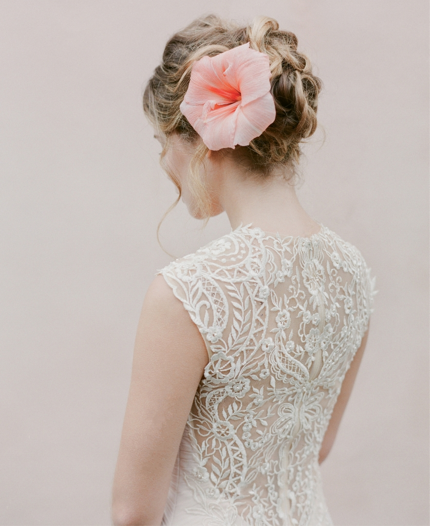 Enchanting by Mon Cheri's 116128 chiffon gown with embroidered  illusion back from Palmetto Bridal Boutique. Amaryllis from Gathering Floral + Event Design.