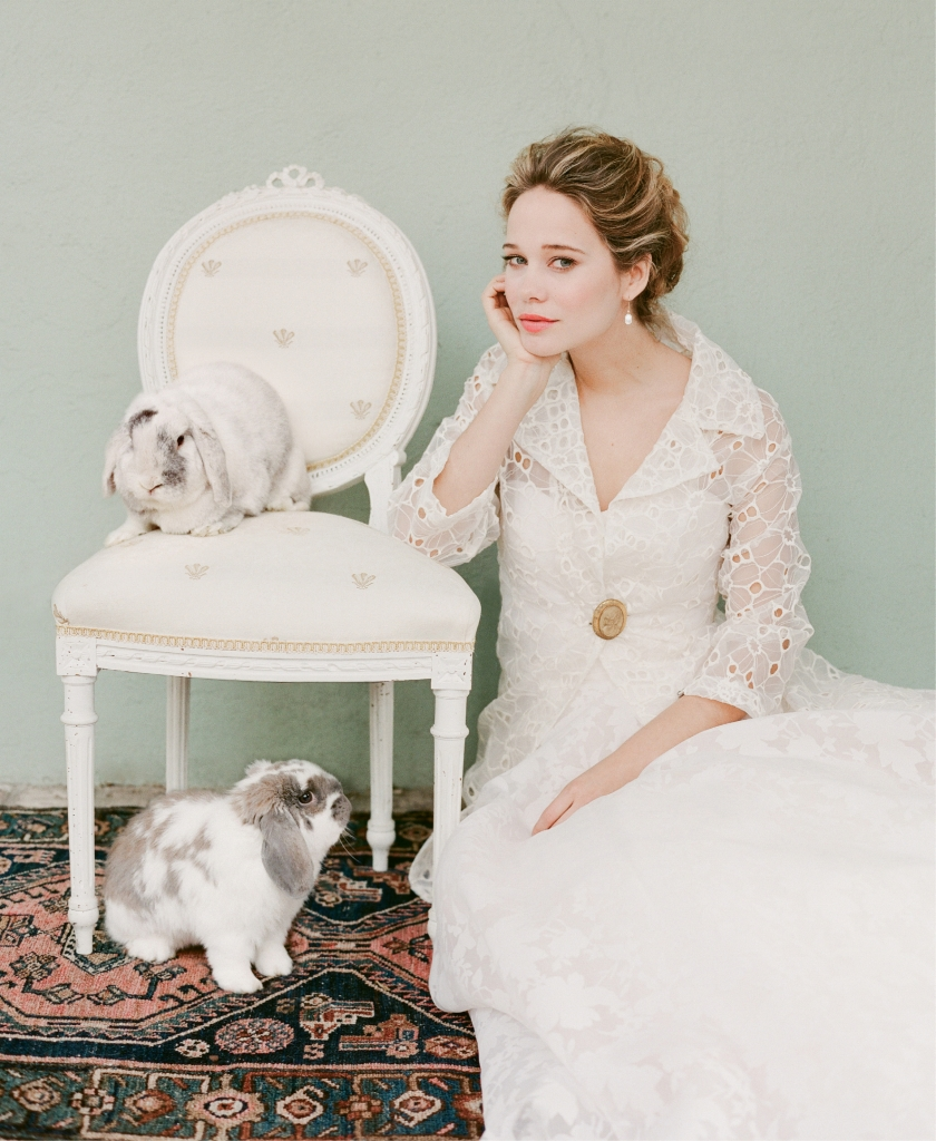 """Jim Hjelm's 8556 silk organza gown with floral print and detachable watteau train from Gown Boutique of Charleston. Ottod'Ame's """"Anna"""" eyelet jacket from Out of Hand. Stylist's antique cameo pin. Diamond and pearl earrings from Roberto Coin."""
