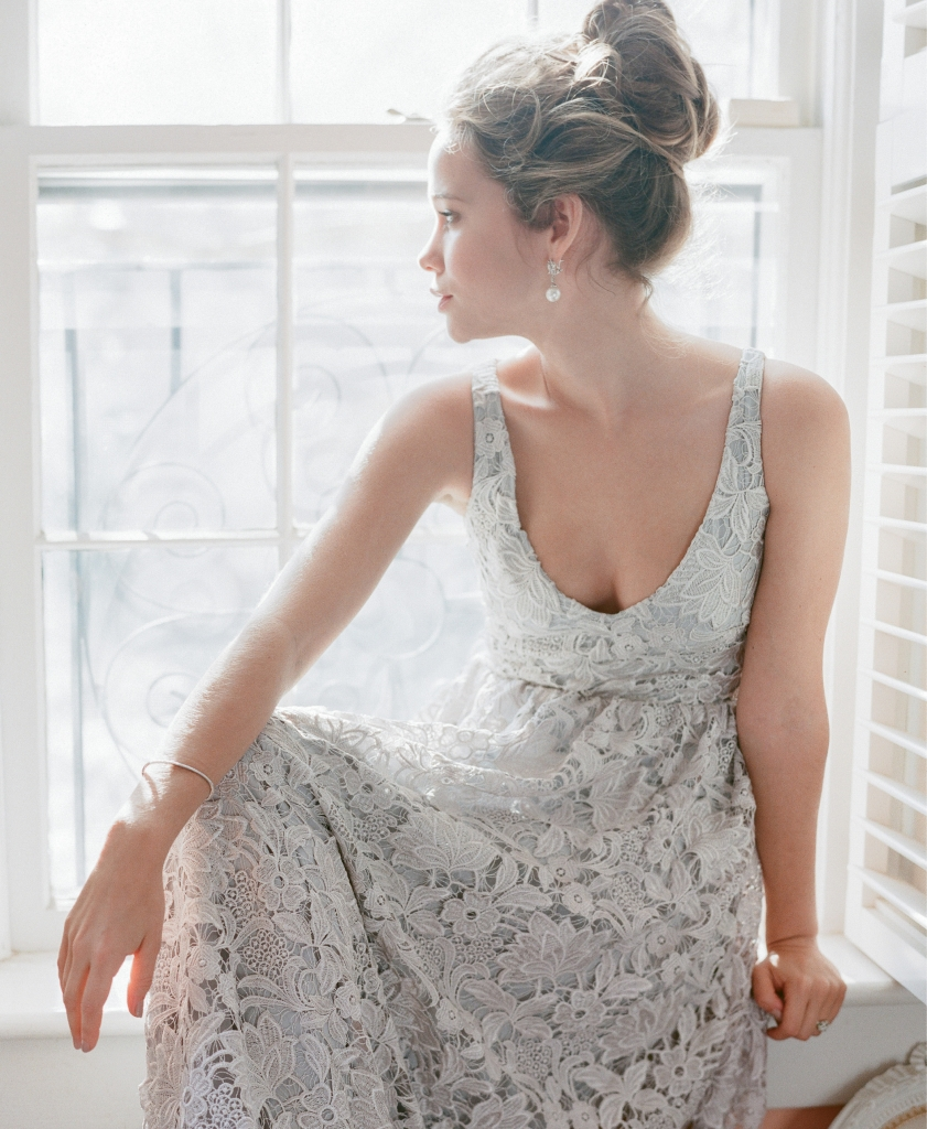 """Katherine McDonald's """"Marlton"""" blue lace gown from Kate McDonald Bridal. 18K yellow gold, diamond, and pearl earrings from Croghan's Jewel Box. David Yurman's sterling silver, topaz, and diamond ring and 14K white gold bangle with diamonds, both from REEDS Jewelers."""