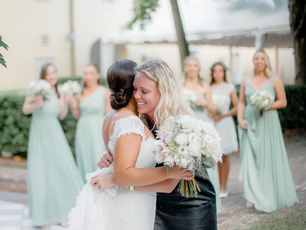 Wedding design by Megan Chandler of Ooh! Events. Florals by Out of the Garden. Bride's gown by Romona Keveza, available in Charleston through Maddison Row. Bridesmaid gowns from J.Crew. Photograph by Brandon Lata at the William Aiken House.