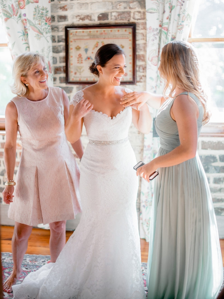 Bride's gown by Romona Keveza, available in Charleston through Maddison Row. Bridesmaid dress from J.Crew. Hair by SWISH. Makeup by Ooh! Beautiful. Photograph by Brandon Lata at the William Aiken House.