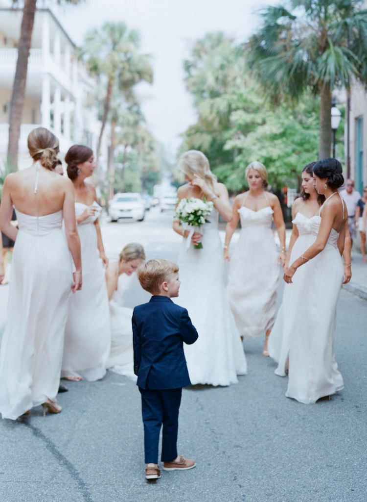 Bride's gown by Monique Lhuillier, available in Charleston through Maddison Row. Bridesmaid gowns by Amsale, available in Charleston through Bella Bridesmaids. Ring bearer attire from J.Crew. Photograph by Elizabeth Messina.