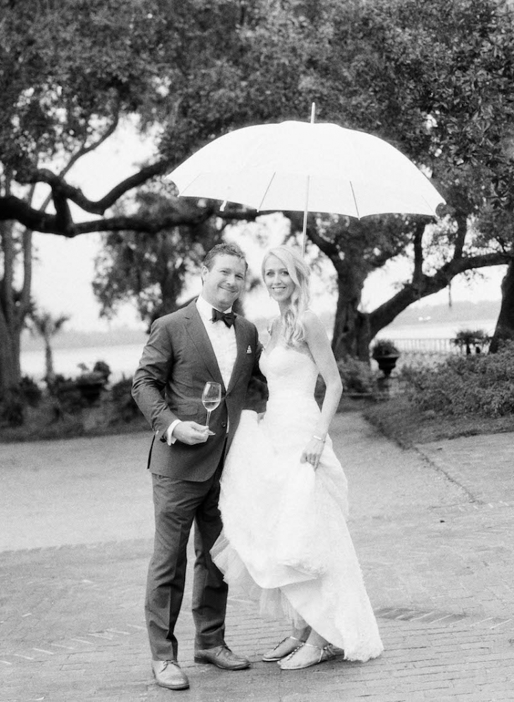 Groom's suit by Michael Andrews and tie from The Tie Bar. Bride's gown by Monique Lhuillier, available in Charleston through Maddison Row. Day-of dress preparation by Cacky's Bride + Aid. Hair by Kristy Cuthbert. Makeup by Moore Makeup. Bride's shoes by Chanel. Photograph by Elizabeth Messina at Lowndes Grove Plantation.
