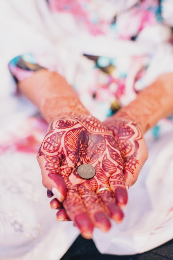 To invite good fortune, Manasa bore intricate henna designs on her palms (painted by a family member of a friend) and tucked a sixpence borrowed from Will's aunt in her shoe. <i>Photograph by Hyer Images</i>