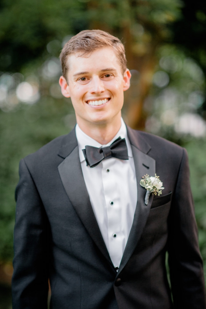 Groom's attire from The Black Tux. Boutonnière by Out of the Garden. Photograph by Brandon Lata.