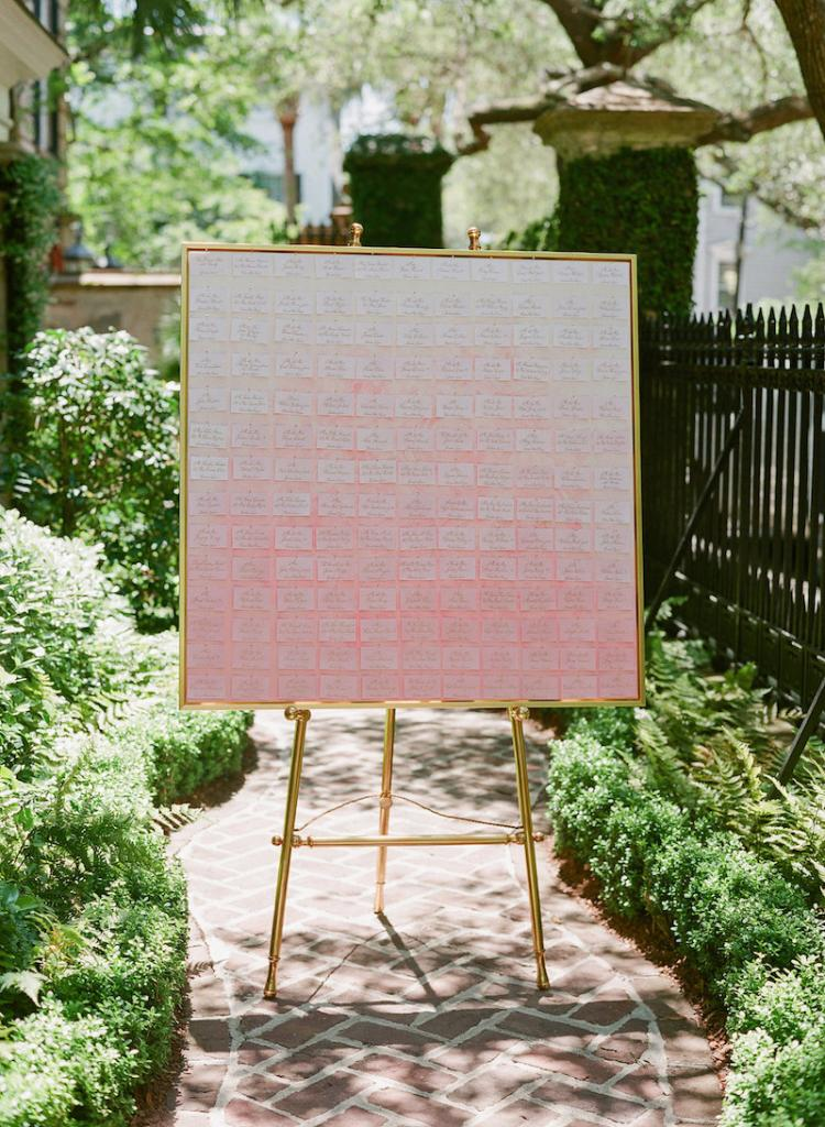 Wedding design by Kristin Newman Designs. Escort card display by Natalie Taylor Humphrey. Photograph by Corbin Gurkin at a private home South of Broad.