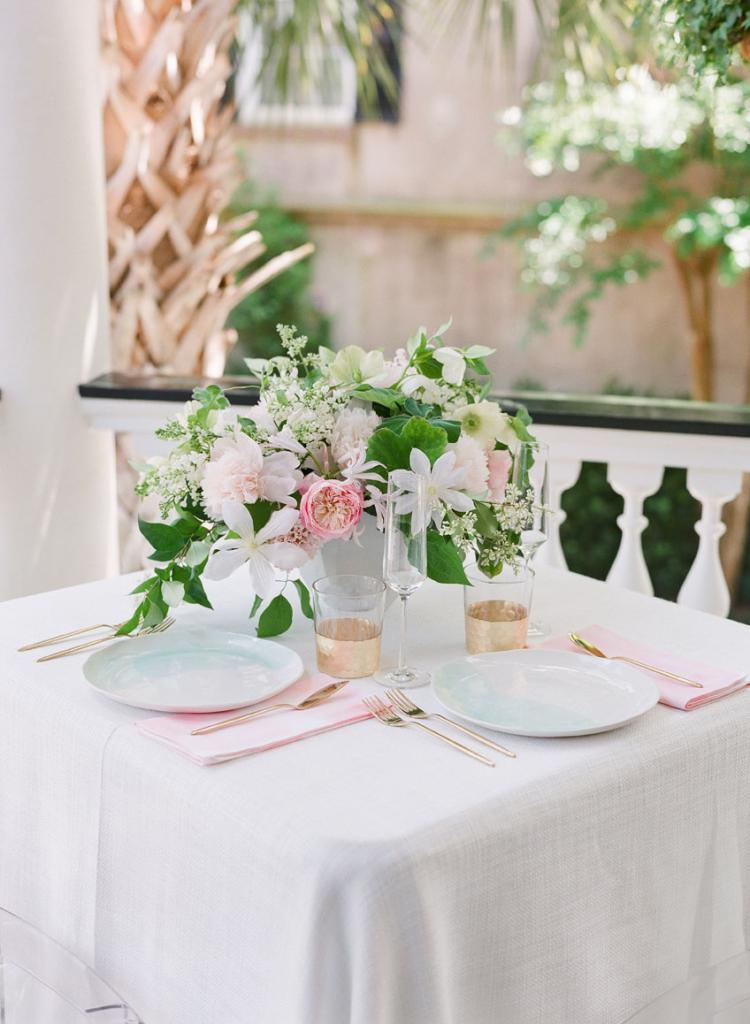 """The newlyweds dined at a sweetheart table on the second-floor piazza. """"We could see everyone but had an intimate moment to soak it all in,"""" says Cate."""