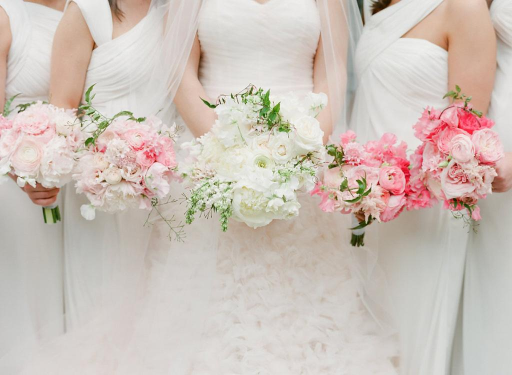 Bride's gown by Monique Lhuillier, available in Charleston through Maddison Row. Bridesmaids' attire by Monique Lhuillier from Bella Bridesmaids. Florals by Gathering Floral + Event Design. Photograph by Corbin Gurkin.