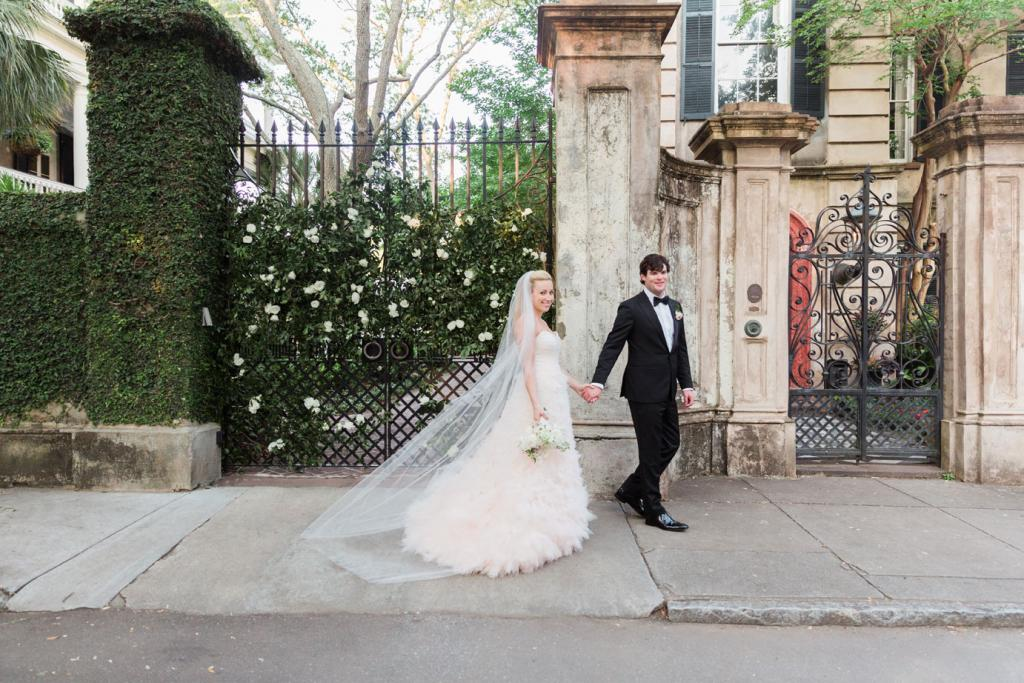 Bride's gown by Monique Lhuillier, available in Charleston through Maddison Row. Hair and makeup by Ashley Brook Perryman. Bridal styling by Lindsey Nowak and Cacky's Bride + Aid. Groom's tux by Ermenegildo Zegna from Gwynn's of Mount Pleasant. Bow tie by Brioni. Photograph by Corbin Gurkin at a private home South of Broad.