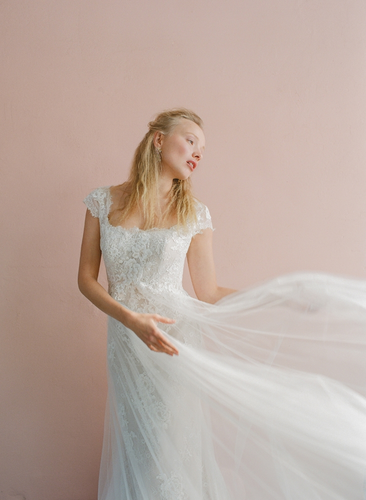 """Pronovias' """"Oasis"""" mermaid gown from Gown Boutique of Charleston. BOUNKIT's amethyst and aquamarine earrings from Gwynn's of Mount Pleasant. <i>Photograph by Corbin Gurkin</i>"""