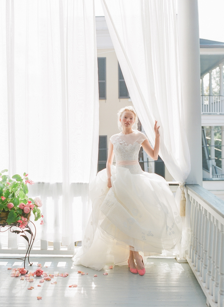 """Peter Langner's """"Waking Up"""" silk organza and guipure lace ball gown from Betty Bridal Atelier. Mizuki's pearl and gold earrings from Croghan's Jewel Box. Jeffrey Campbell's """"Bitsie"""" suede pumps in dark coral from Shoes on King. <i>Photograph by Corbin Gurkin</i>"""
