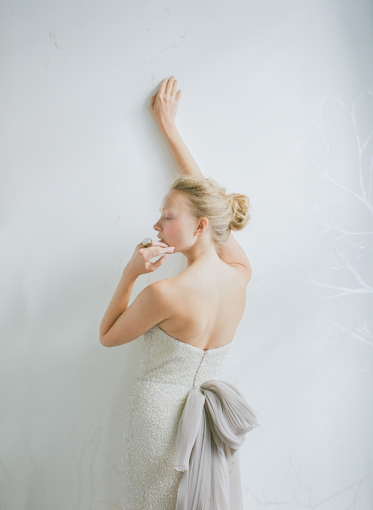 """Carol Hannah's """"Alyxia"""" sequined gown with pleated organza bowed train in wisteria from Southern Protocol Bridal. Claudia Labao's white druzy and wood ring from Out of Hand. <i>Photograph by Corbin Gurkin</i>"""