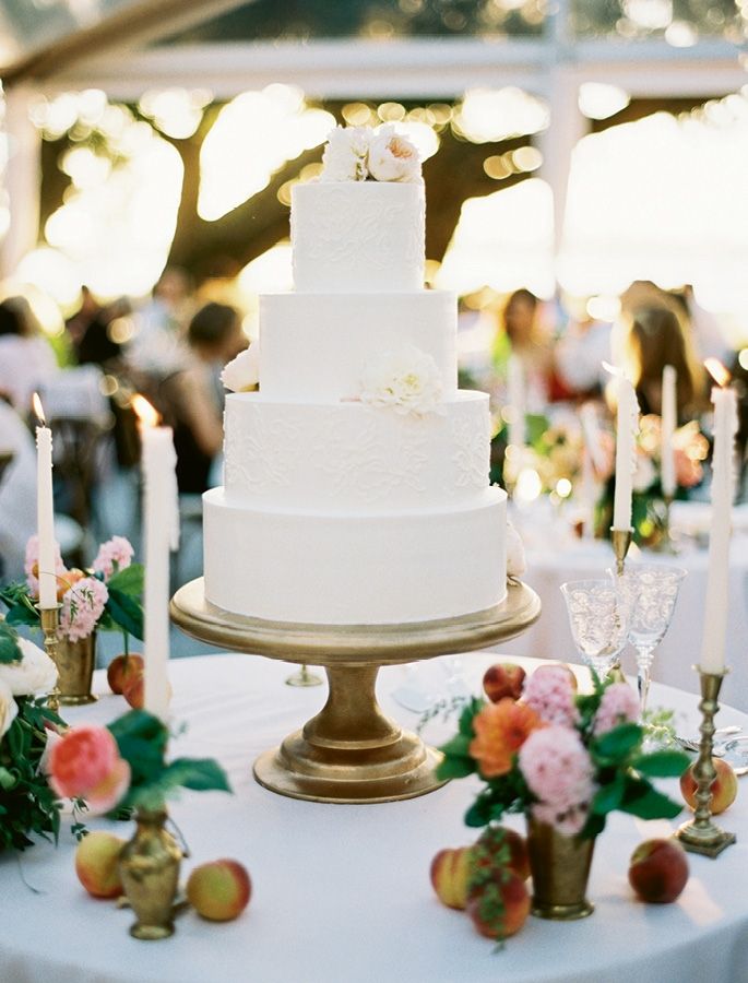 Give & Take - Pale linens, icing, cake flowers, and tapers make colorful blooms (and fruit) stand out all  the more.