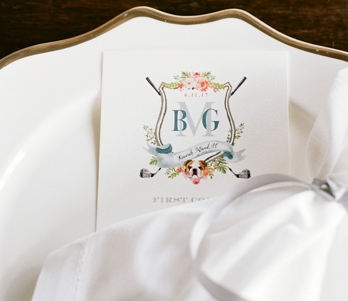 Look close to see the golf clubs and bulldog face in the crest that the bride's sister created.