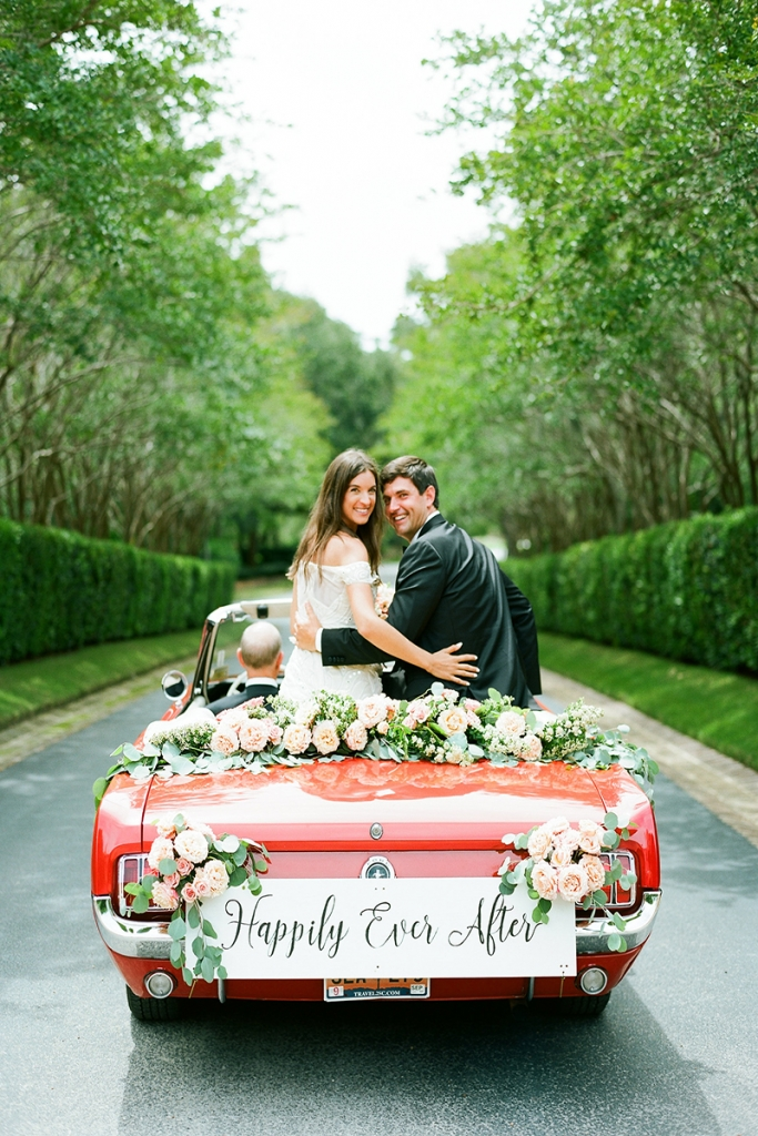 """The couple left the reception in the father of the bride's 1965 Ford Mustang convertible. Brooke's mother penned the """"Happily Ever After"""" sign, which now hangs in the newlywed's bedroom."""