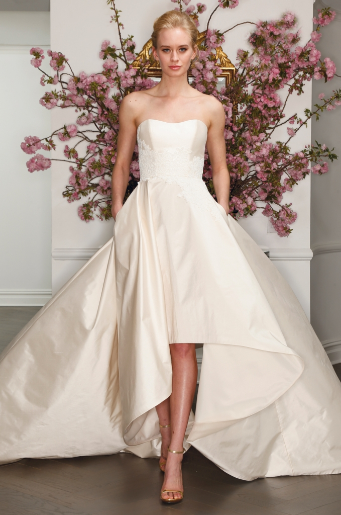 TREND: Taffeta with lace appliqué (Look close! It's on the bodice. And bonus: high-low and pockets done impeccably.)  GOWN: Legends by Romona Keveza's L7130, available in Charleston through Maddison Row