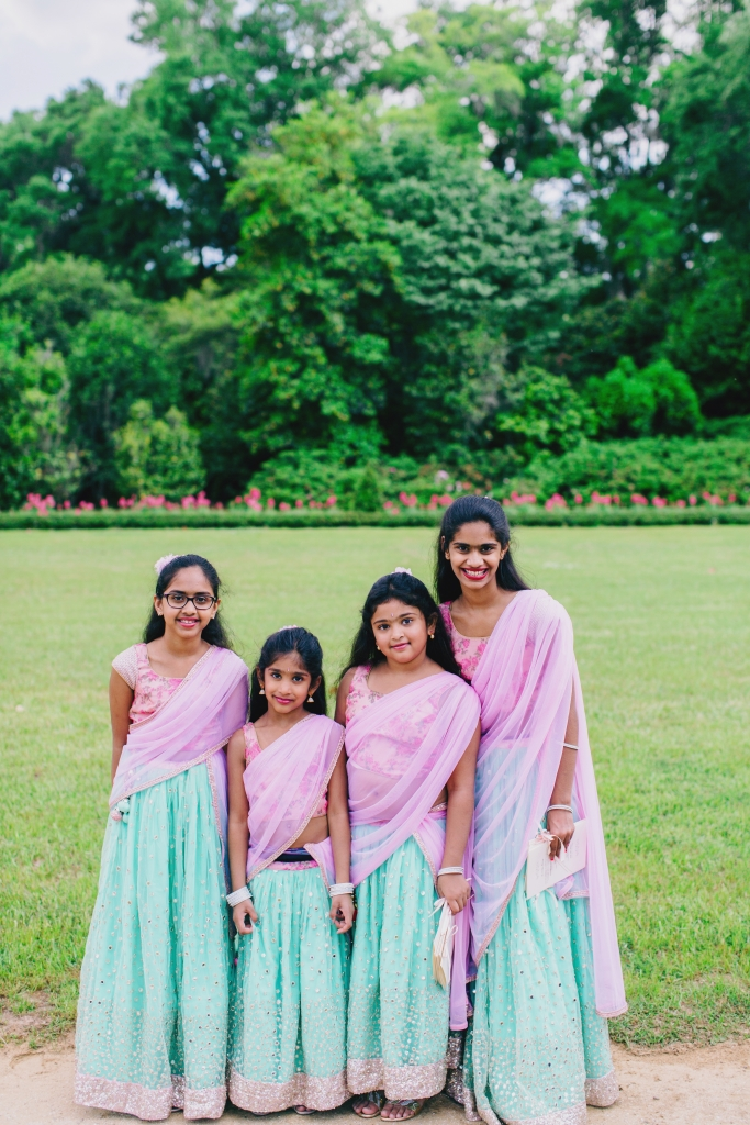 Manasa's junior bridesmaids wore pink and seafoam green lehengas designed by the bride and her mother. <i>Photograph by Hyer Images</i>