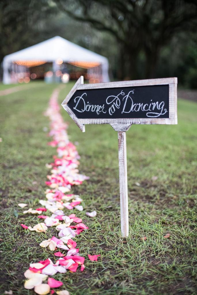 Signage and florals by Engaging Events. Calligraphy by Calligraphy by Request. Photograph by Marni Rothschild Pictures at the Legare Waring House.