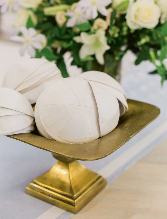 Old & New - Temper frivolity with traditional touches, like Robert and Lesley did by marrying under a chuppah and providing guests with yarmulkes.  <i>Photograph by Liz Banfield</i>