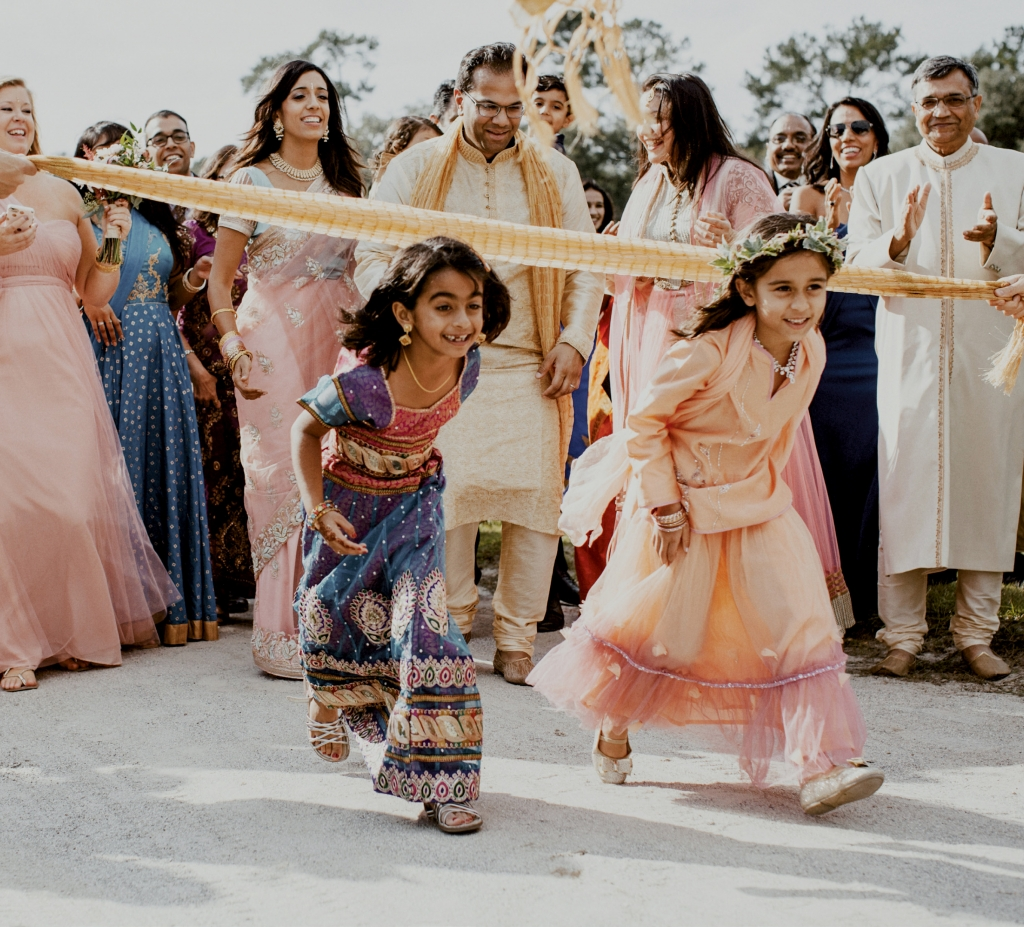 """""""The baraat is a huge party before the ceremony,"""" says bride Jennifer Deitz who exchanged vows with Agam Jain at Middleton Place in an Indian fusion wedding. """"Everyone gets pumped and excited."""""""
