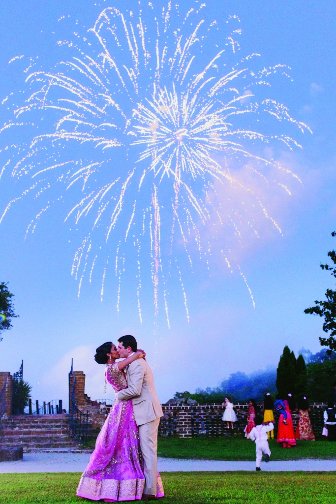 """I wanted a fireworks display to  give us a chance to pause and take it all in,"" Manasa says. As a surprise, Luke arranged for a longer, more exciting display than they'd discussed. ""All the children running and screaming in pure joy made those minutes spectacular,"" says the bride. <i>Photograph by Hyer Images</i>"