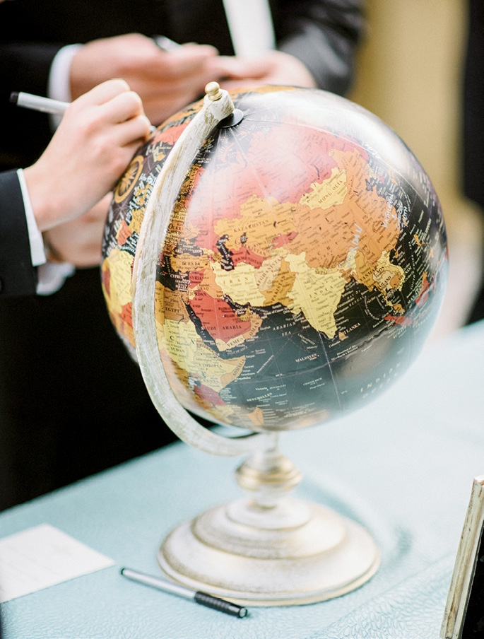Guests signed a small  globe the couple now  keeps at home for  a sentimental  decoration. (Photograph by Sean Money + Elizabeth Fay)