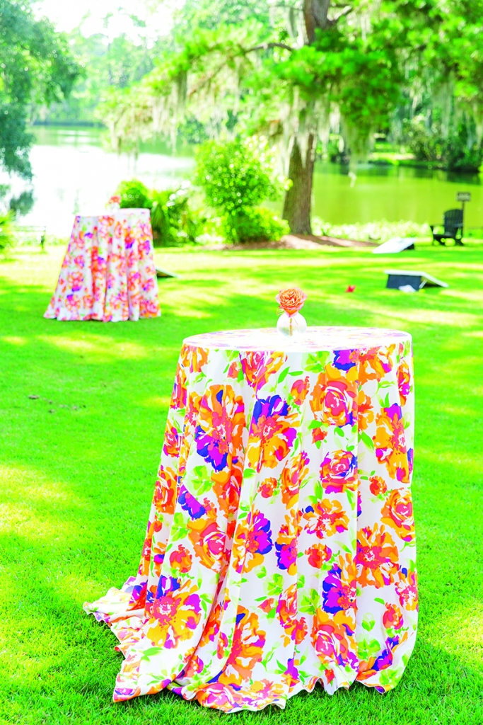 """Vibrantly patterned linens and boldly hued florals took over the cocktail hour. """"Remembering those tablecloths make me and my mom smile to this day,"""" says Andra of BBJ Linen's """"Blumen Shantung."""""""