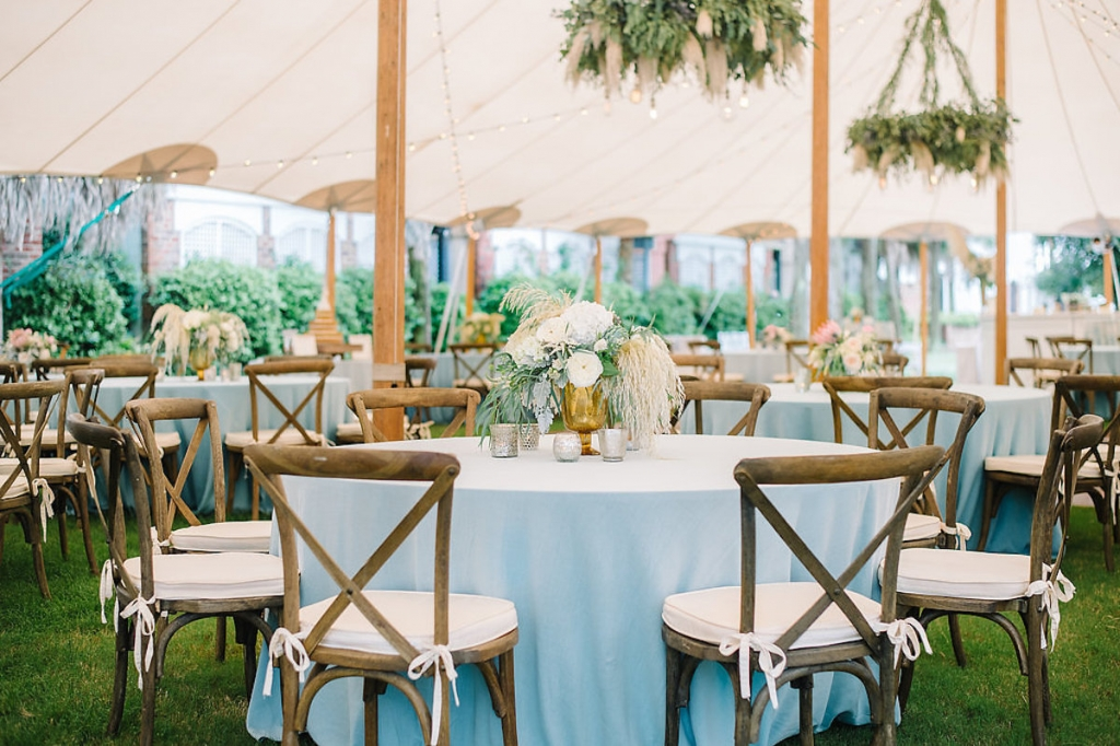 Wedding design by Sweetgrass Social. Florals by Branch Design Studio. Rentals from EventWorks. Tent from Sperry Tents Southeast. Linens from La Tavola. Image by Aaron and Jillian Photography.