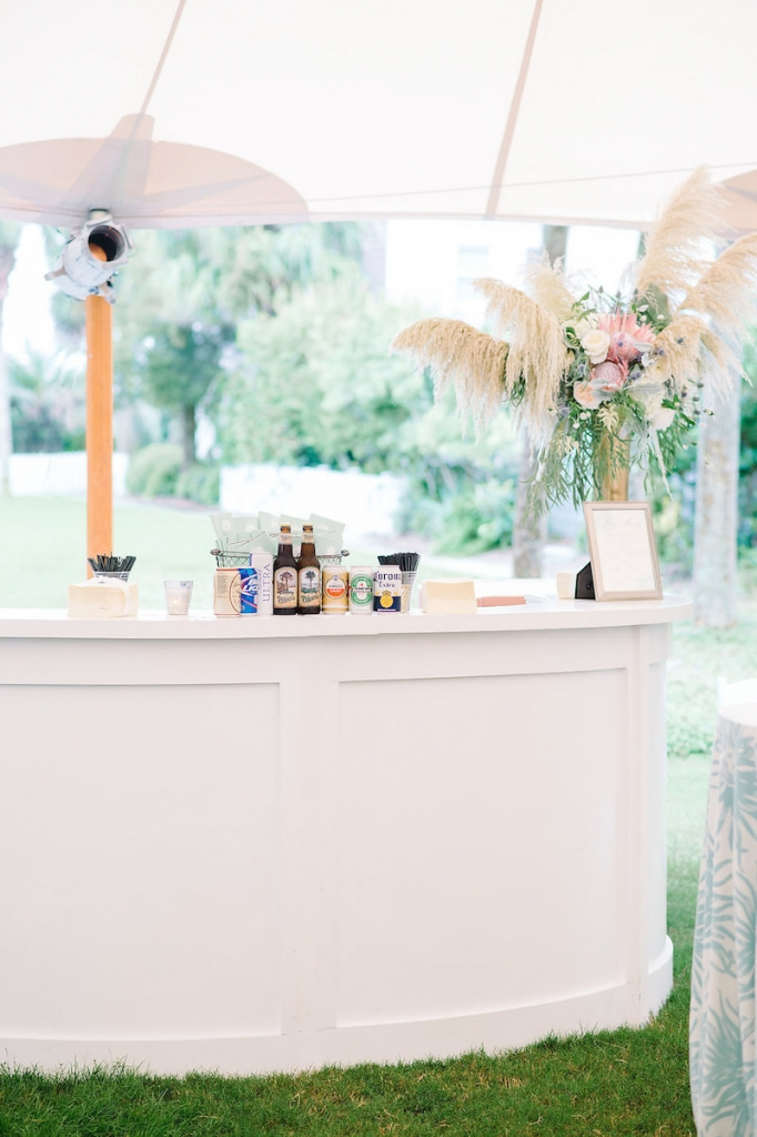 Wedding design by Sweetgrass Social. Rentals from EventWorks. Bar service by Wild Dunes Resort. Florals by Branch Design Studio. Tent from Sperry Tents Southeast. Image by Aaron and Jillian Photography.