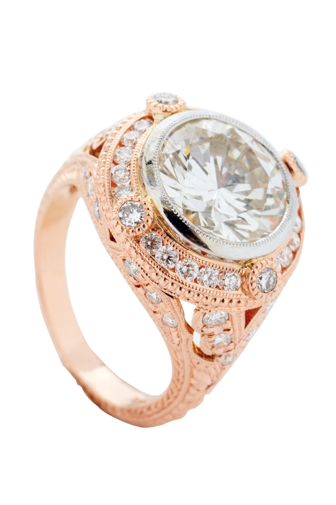 18K rose-gold ring with 4.01 ct. diamond center and accent diamonds (.77 total cts.) from Polly's Fine Jewelry (price upon request)    <i>Photograph by Christopher Shane</i>