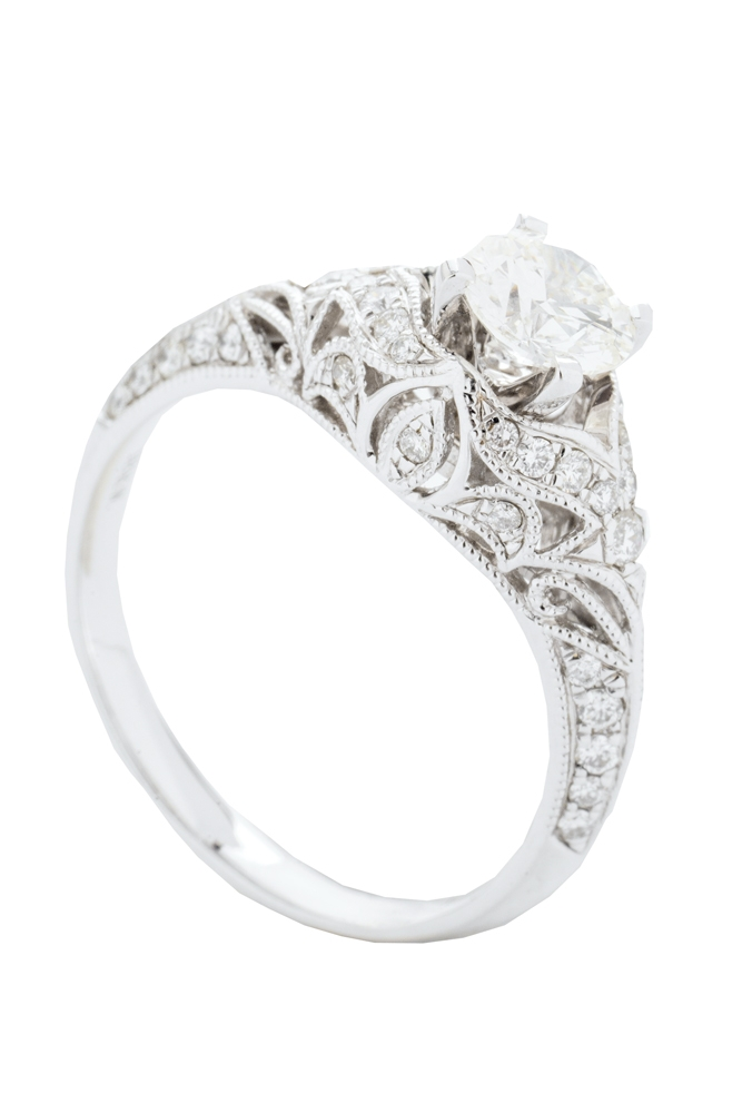 Forevermark's  10K white-gold ring with .7 ct. diamond center and accent diamonds (.31 total cts.) from Paulo Geiss Jewelers ($4,680)   <i>Photograph by Christopher Shane</i>