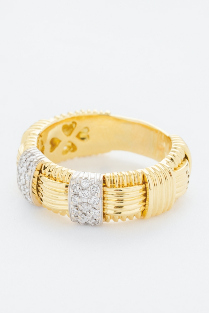 Appassionata Collection by Roberto Coin's 18K yellow-gold ring with diamonds  (.2 total cts.) from Roberto Coin ($3,500)    <i>Photograph by Christopher Shane</i>