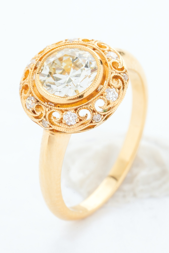 Single Stone's 18K  yellow-gold ring with  1.01 ct. center diamond and accent diamonds (.13 total cts.) from Croghan's Jewel Box ($8,700)    <i>Photograph by Christopher Shane</i>