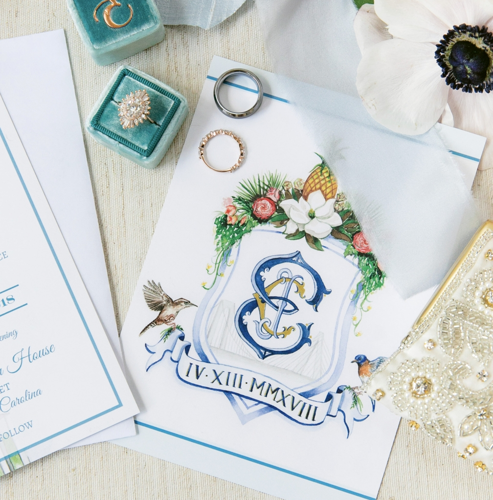 When Caitlin Smith wed Joseph Eyerman at The William Aiken House, the Etsy illustrator painted this crest with his-and-her, New York-meets-South Carolina elements. Crest by the Fox and Bloom. Image by Dana Cubbage Weddings