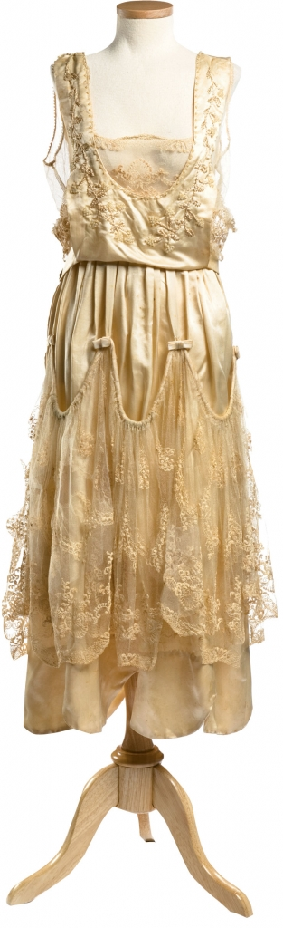Annie Kangeter, 1921: Charleston's Annie Kangeter wore this tea-length silk and lace dress (stitched by her sister) to marry Charles D. Boette on April 14, 1921. Loose draping gracing both the bodice and skirt added a feminine (and super stylish) layered look to her flapper-chic frock.