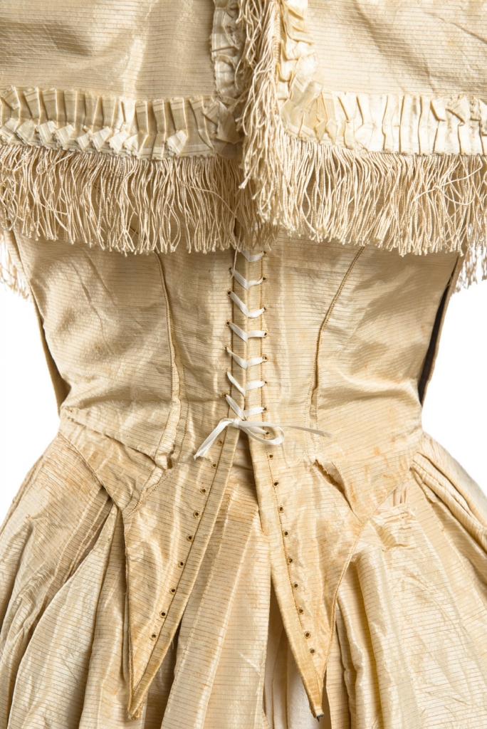 Louisa Jane Dearing, 1859. Close-up of her wedding gown from the back and its lace up corset bodice