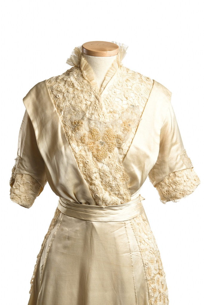Wilhelmina Dorothea Meyer, 1914: While simple, unstructured silhouettes were all the rage at the start of the 20th century, the clusters of pearls, glass beading, lace and tulle trim, and watteau train of bride Wilhelmina Dorothea Meyer's silk gown added special-occasion sophistication in spades. Wilhelmina wed Adolph Gevert Hollings on January 7, 1914, in the Holy City.