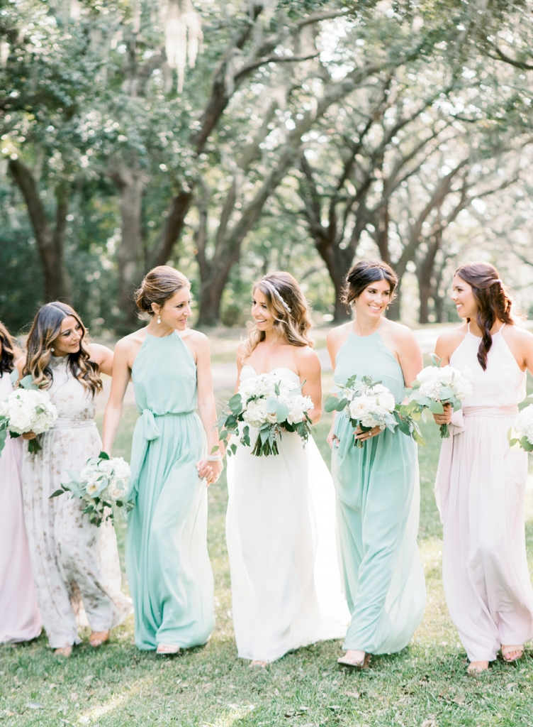 """After gleaning inspiration from  Pinterest, Dani knew she wanted her attendants to don gowns in different hues and prints. To keep the look streamlined, she chose one frock—""""Alana"""" from BHLDN—that was offered in a host of coordinating colors and patterns.   <i>Image Aaron & Jillian Photography</i>"""