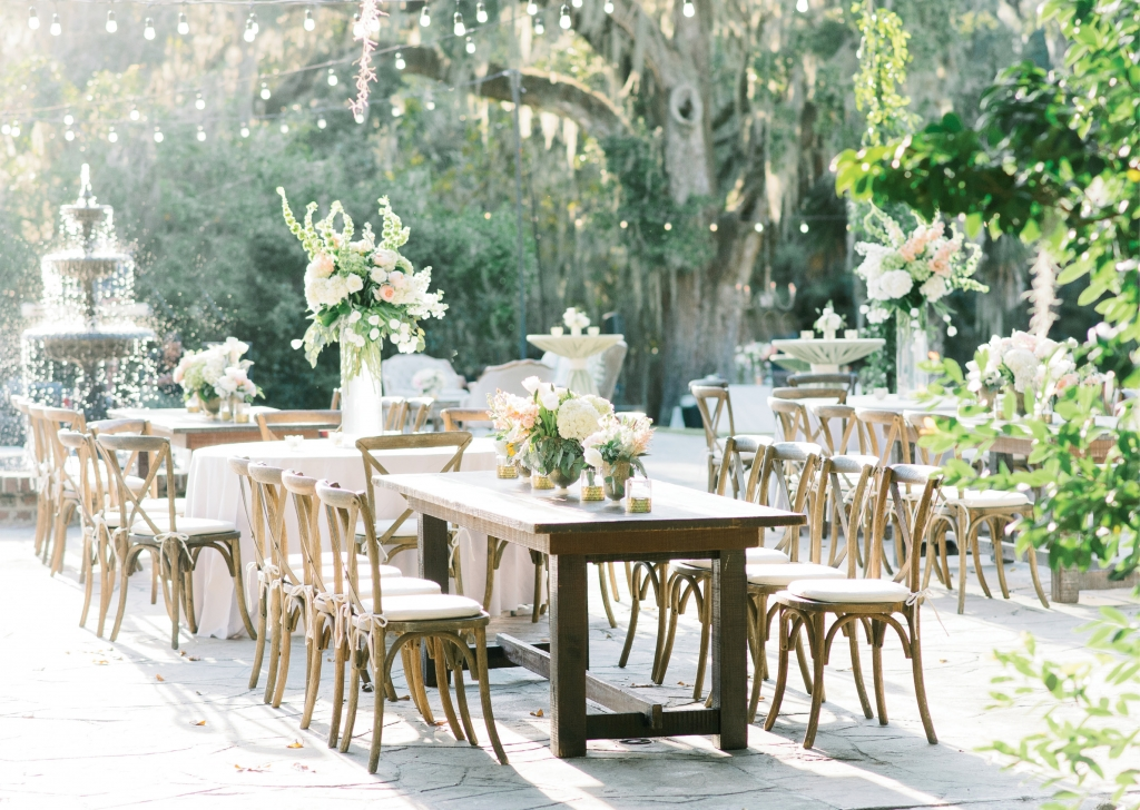 Though rich mahogany folding chairs were originally slated for the dinner space, the team at Fox Events swapped lighter-hued X-back chairs in at the last minute to better suit the palette of the florals.  <i>Image Aaron & Jillian Photography</i>
