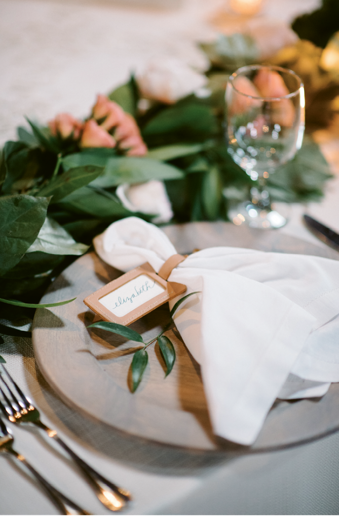 """Custom leather luggage tags stamped with """"Say 'I do' to new adventure"""" were used for place cards and gifted as favors. (Photograph by Sean Money + Elizabeth Fay)"""