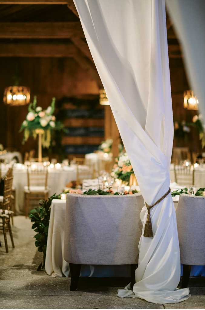 """""""Elizabeth wanted something beautiful and elegant but recognized that the reception was in a barn setting,"""" says A Charleston Bride planner Lindsey Shanks. """"I love when a client understands not to 'fight the grain' of a space but opts to softly illuminate its features."""" (Photograph by Sean Money + Elizabeth Fay)"""