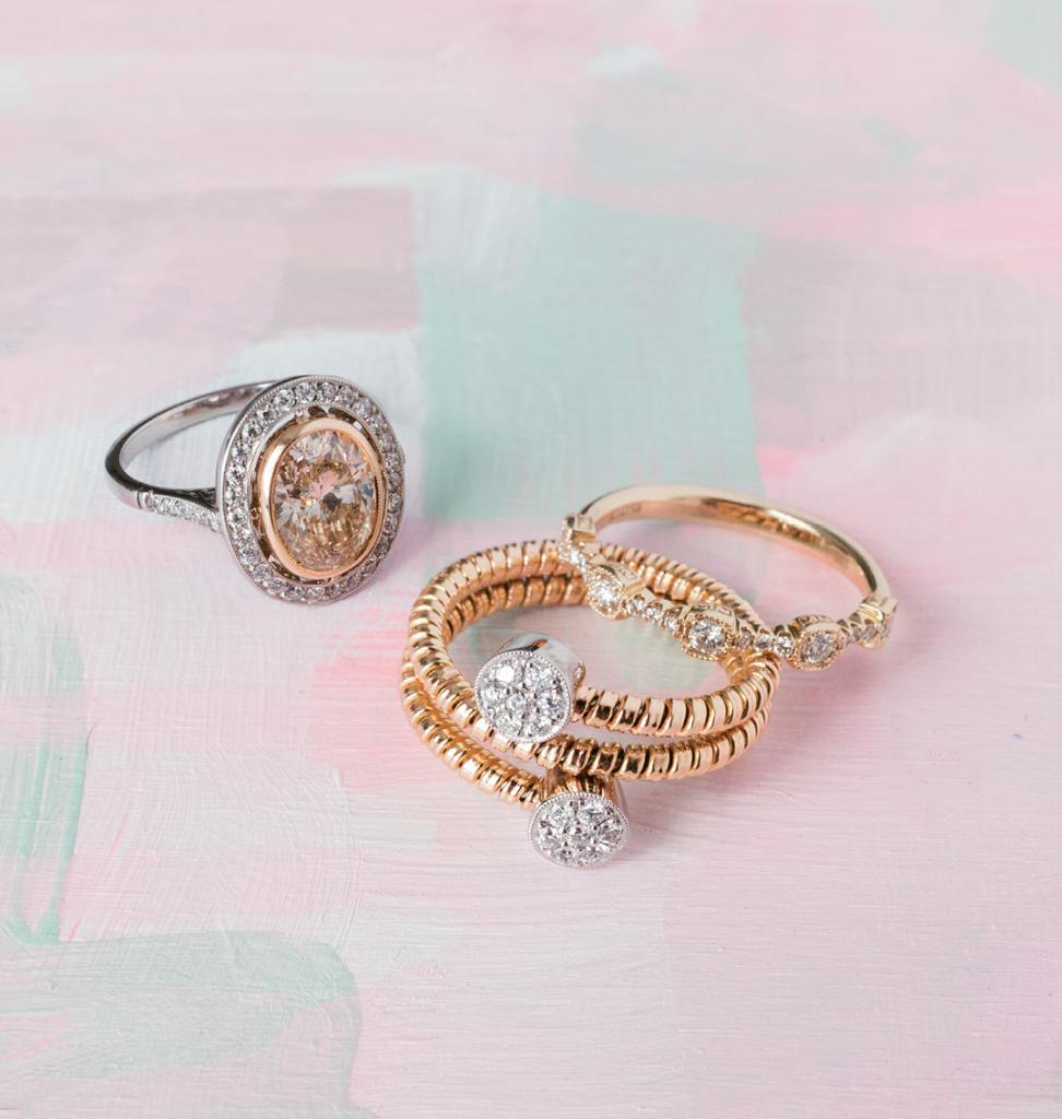 (from left) Single Stone's 18K yellow gold and platinum ring with 2.09 ct. champagne-colored diamond center and accent diamonds (.35 total cts.) from Croghan's Jewel Box, $16,400. Christopher Designs' 14K yellow gold band with diamonds (.3 total cts.) and Caviar Collection by Simon G.'s 18K rose and white gold ring with diamonds (.023 total cts.), both from Diamonds Direct, $1,260 and $1,980, respectively. Artwork by Natalie Taylor Humphrey