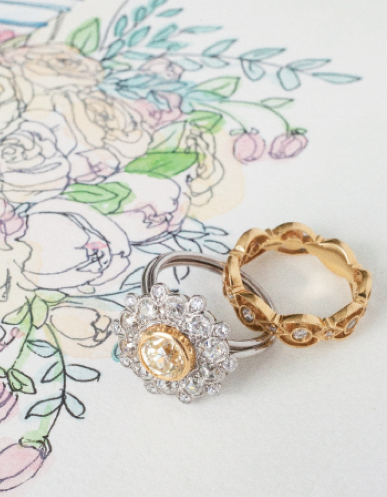 (from left) Platinum and yellow gold ring with 1.46 ct. diamond center and accent diamonds (2.86 total cts.) from Joint Venture Estate Jewelers, $12,500. Gabriel & Co.'s 14K yellow gold band with diamonds (.3 total cts.) from Polly's Fine Jewelry, $1,950. Artwork by Natalie Taylor Humphrey