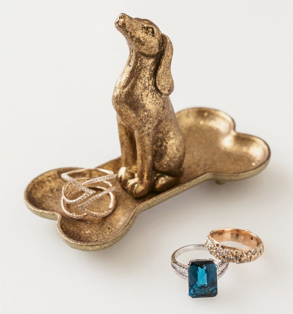 Gabriel & Co.'s diamond and gold ring ($1,450 from Polly's Fine Jewelry). PE Jay Creation's London blue topaz, diamond, and gold ring ($1,550 from Diamonds Direct). Polly Wales' white and rose diamond and gold ring (price upon request from RTW). Dog stand ($8 from Southern Accent Designer Showcase).   <i>Photograph Gayle Brooker</i>