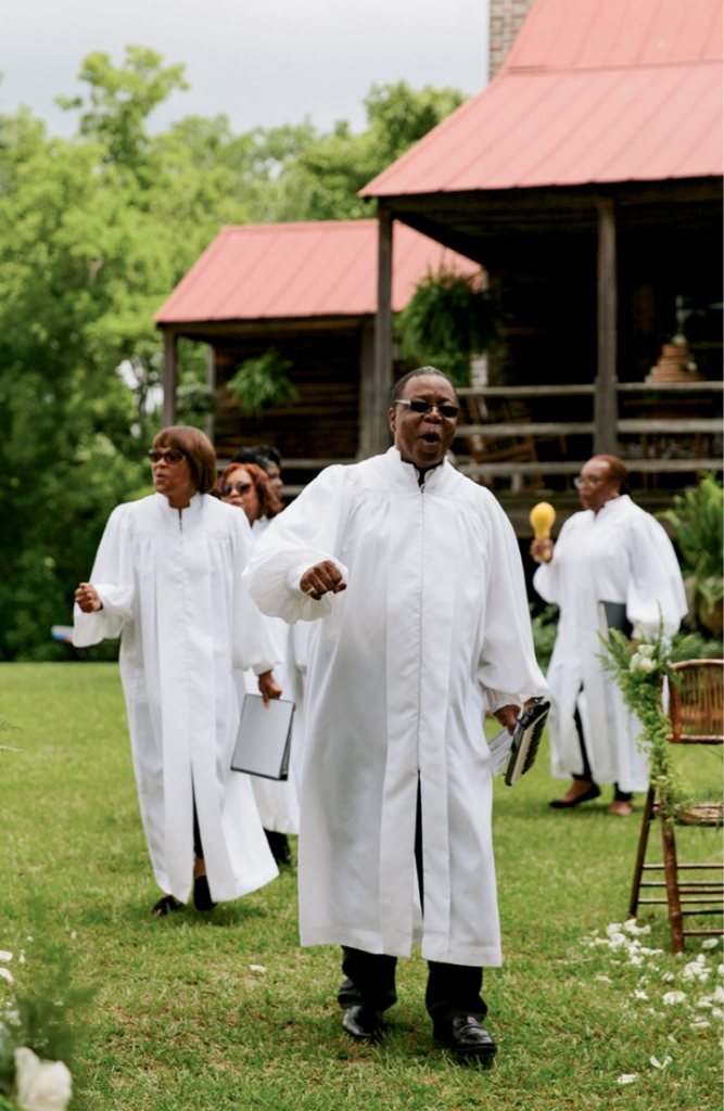 """To start the ceremony, Voices of Deliverance sang spirituals. Says Liz, """"It seemed important not to erase that part of the property's heritage."""" <i>Photograph by Olivia Rae James</i>"""