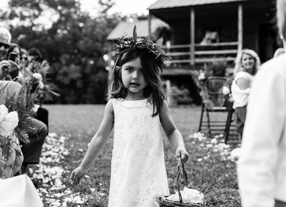 Flower girl Olivia (the mother-of-the-bride's cousin's daughter) wore a miniature version of the bridesmaids' leafy crowns.  <i>Photograph by Olivia Rae James</i>