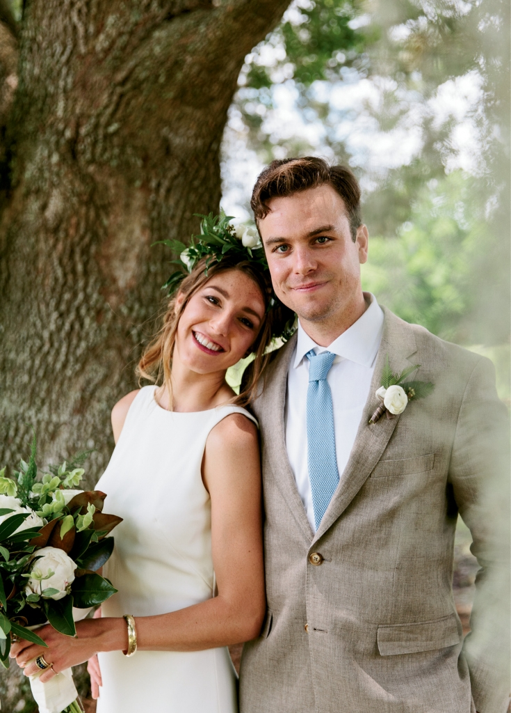 """Liz, a writer, and Thomas, who works in advertising and marketing, look squeaky clean here, but that wasn't the case after some water slide antics. """"His suit was covered in grass stains, and my dress ended up in my parents' shower, but it was entirely worth it,"""" says Liz.  <i>Photograph by Olivia Rae James</i>"""