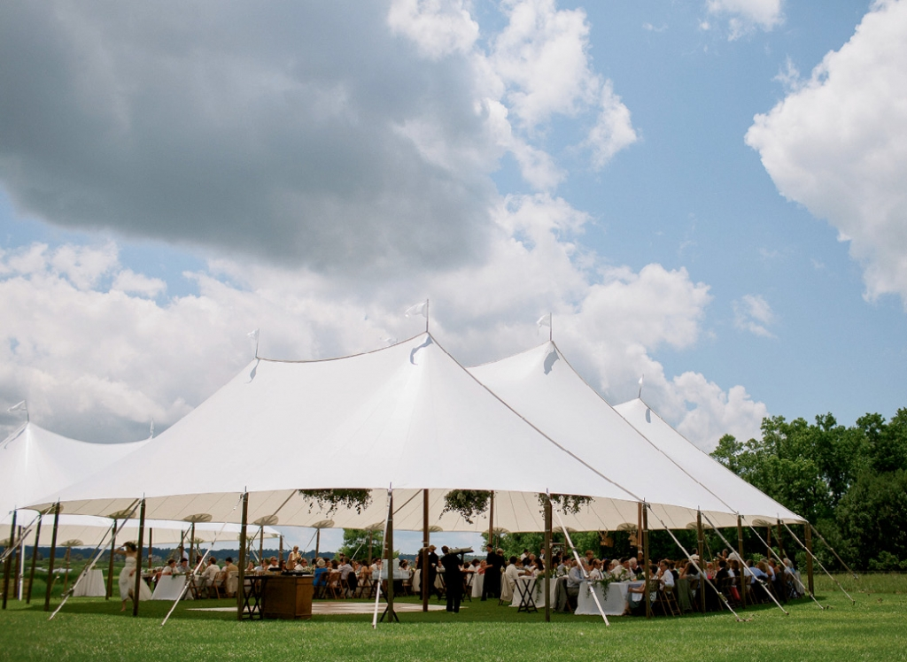 A sailcloth tent shielded guests (who were warned to dress for a Southern summer) from the sun.  <i>Photograph by Olivia Rae James</i>